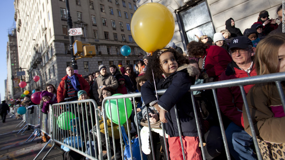 People line up in Central Park West on Thursday in anticipation for the parade.