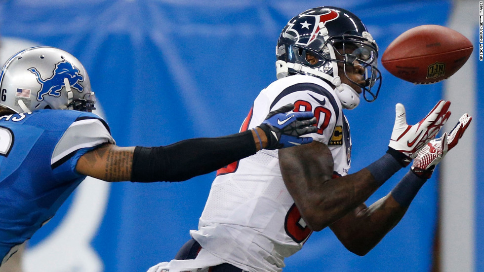 Andre Johnson of the Houston Texans makes a catch in front of Louis Delmas of the Detroit Lions on Thursday.