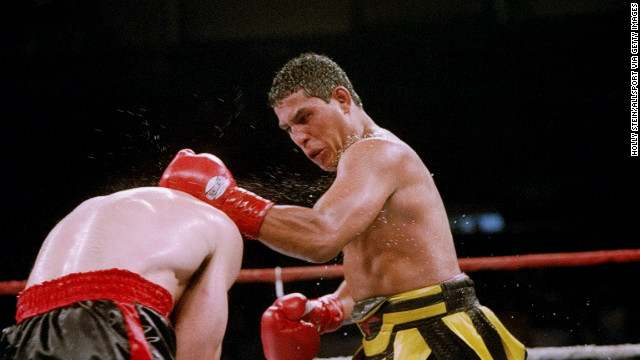 19 Jun 1993: Hector Camacho (right) lands a punch on opponent Tom Alexander. Mandatory Credit: Holly Stein /Allsport