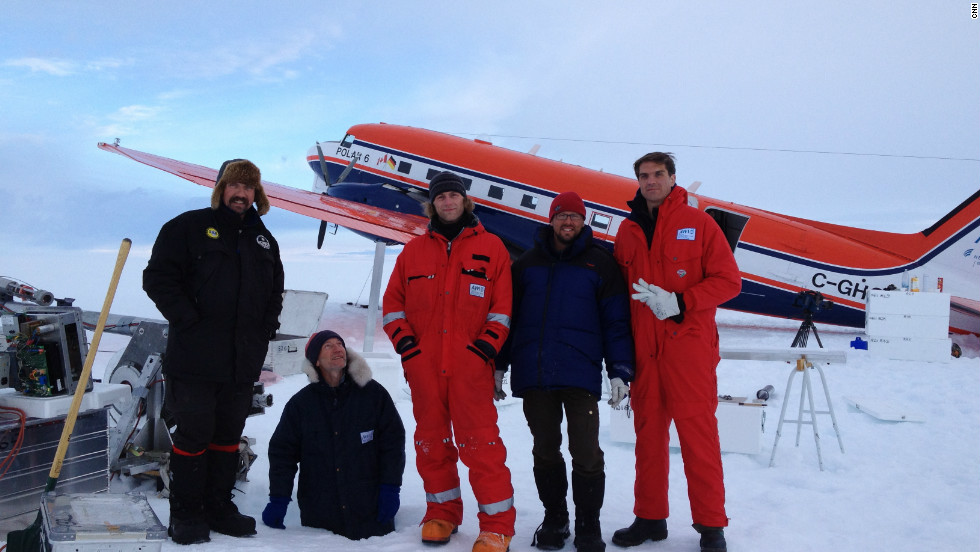 Ice core drilling crew with CNN correspondent Fred Pleitgen. Glaciologist Sepp Kipfstuhl standing in a hole for fun!