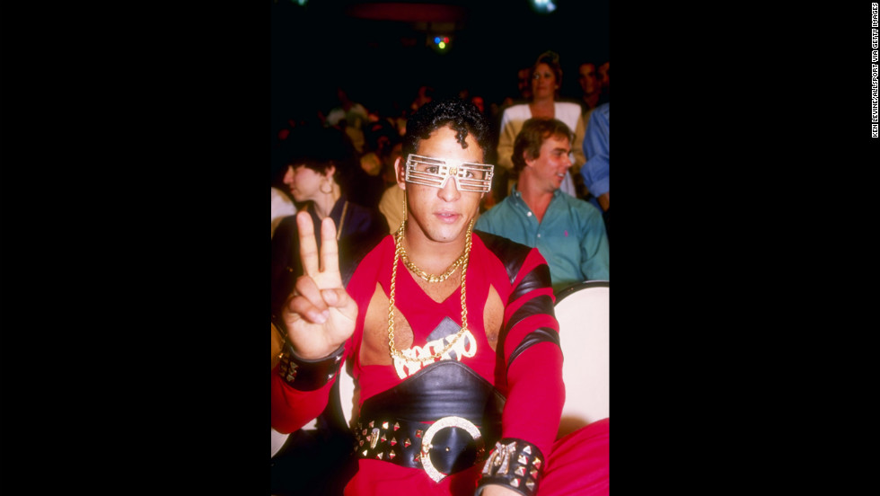 Camacho gives the peace sign while watching a 1991 bout between Julio Cesar Chavez and Lonnie Smith in Las Vegas. Camacho was considered a promoter's dream because he was a showman in the ring against some of the greatest fighters of his era.