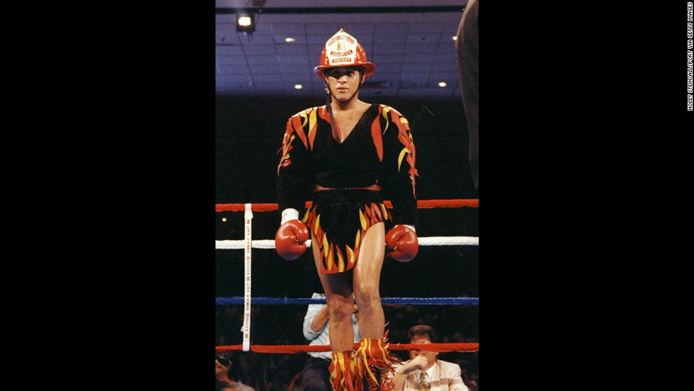 Before his 1992 fight against Eddie Van Kirk, Camacho stands in the ring wearing a firefighter hat and an outfit adorned with flames.