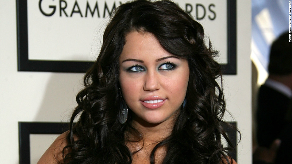 "At the 50th Grammy Awards in February 2008, Cyrus debuted a more severe look than fans had seen in the past. In April of that year, <a href=""http://www.cnn.com/2008/SHOWBIZ/Music/04/28/cyrus.photos/index.html""> Cyrus came under fire</a> for an infamously suggestive photo in Vanity Fair that implied she was topless."