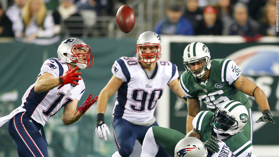 Julian Edelman of the New England Patriots looks to catch the ball after a fumble by No. 25 Joe McKnight of the New York Jets during the Thanksgiving Day game. Edelman scored a touchdown on the play.