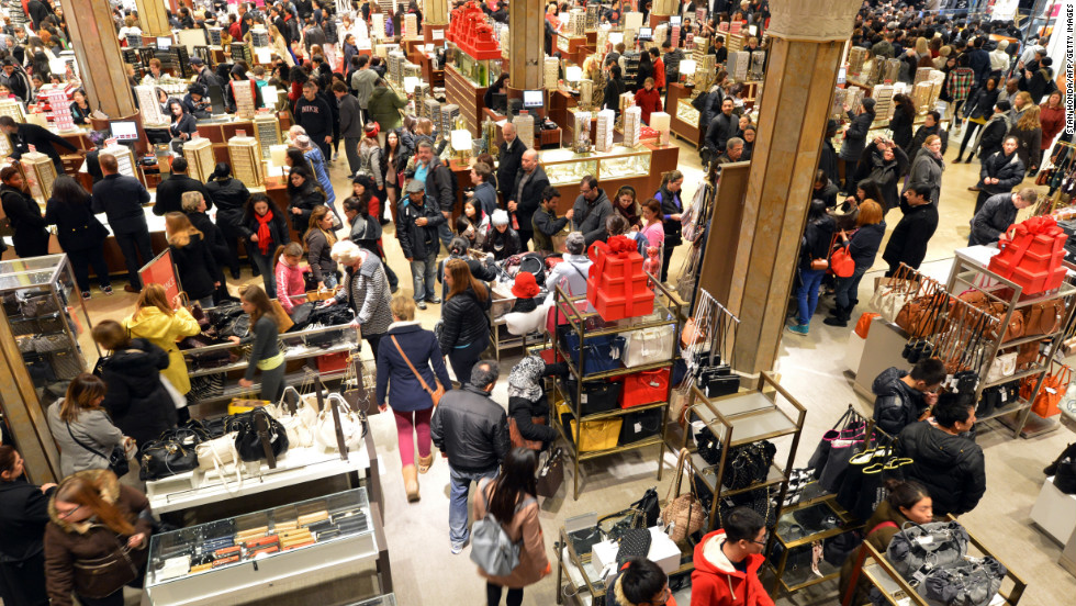 The first floor of Macy's in New York is crowded when the store opens at midnight.