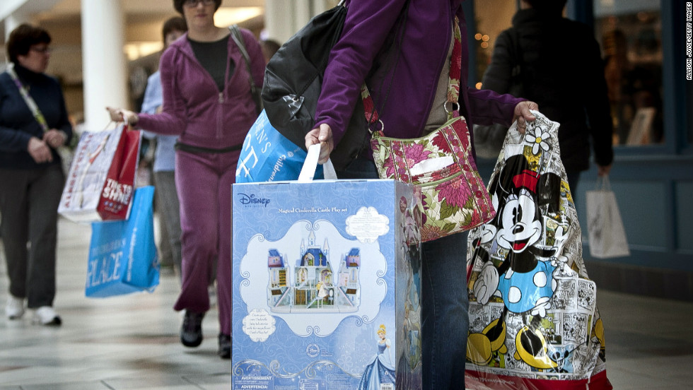 Shoppers carry bags during Black Friday sales at the South Shore Plaza in Braintree, Massachusetts.