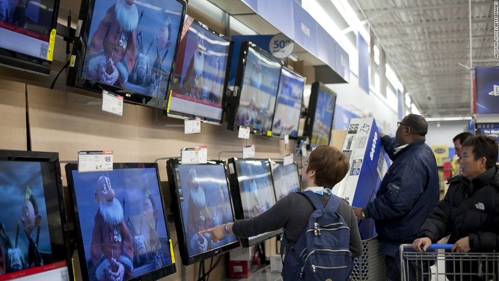Shoppers pick out televisions at Walmart during Black Friday sales in Quincy, Massachusetts.