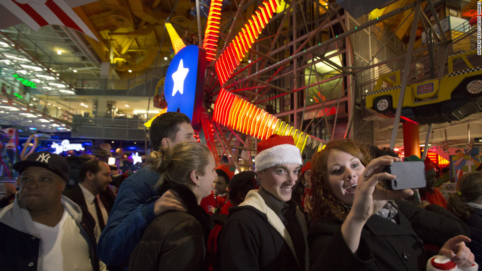 Shoppers enter Toys R Us in Times Square on Thanksgiving Day.