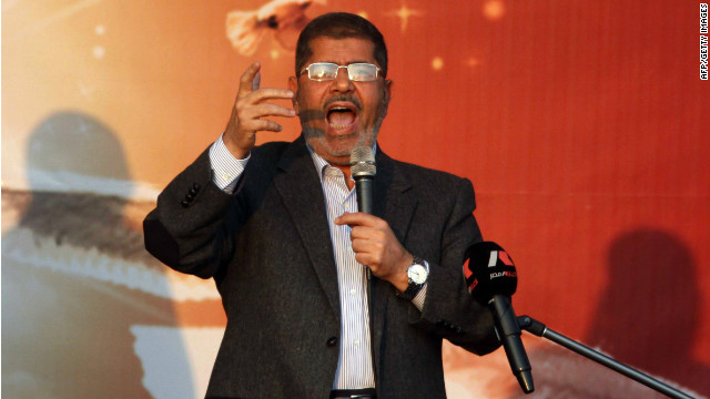 Egyptian President Mohamed Morsy waves to his supporters in front of the presidential palace in Cairo on November 23.