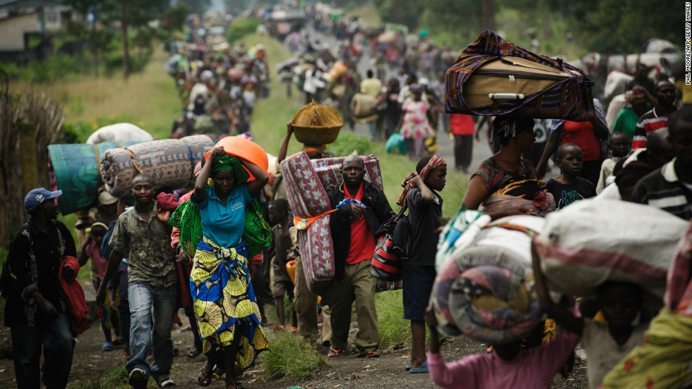 The M23 rebel group is fighting the Democratic Republic of Congo military for control of the country, and the violence is driving tens of thousands of Congolese out of their homes. Here on November 22, thousands fled the town of Sake and headed east to the camps for displaced in the village of Mugunga.
