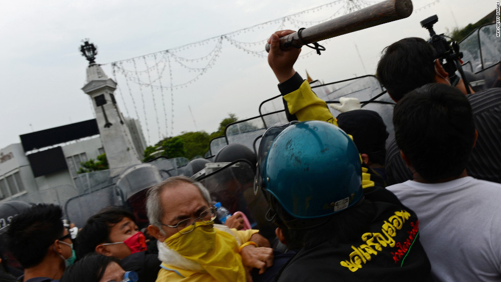 Demonstrators press toward police during a large anti-government protest on Saturday, November 24, in Bangkok, Thailand. The Siam Pitak group, which sponsored the protest, cited alleged government corruption and anti-monarchist elements within the ruling party as grounds for the protest. Police used tear gas and baton charges againt protesters.