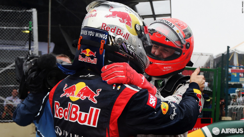 Michael Schumacher congratulates fellow German Vettel on his title triumph. Seven-time world champion Schumacher finished seventh in his final race before retirement.