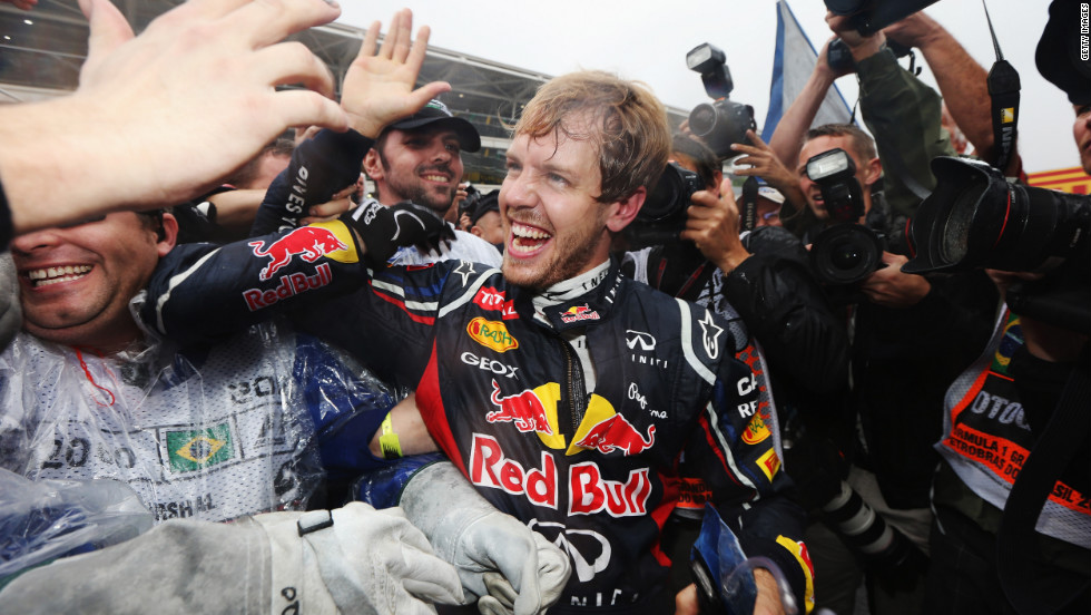 Vettel celebrates with his team and admirers after a pulsating race at Interlagos. There's sure to be a big party after another fantastic season for the German driver and the Red Bull team.