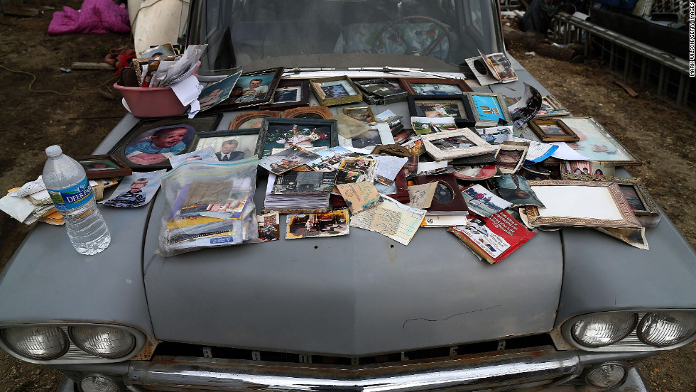Old photographs are laid out to dry on a car hood on Sunday after being removed from a home in Seaside Heights.