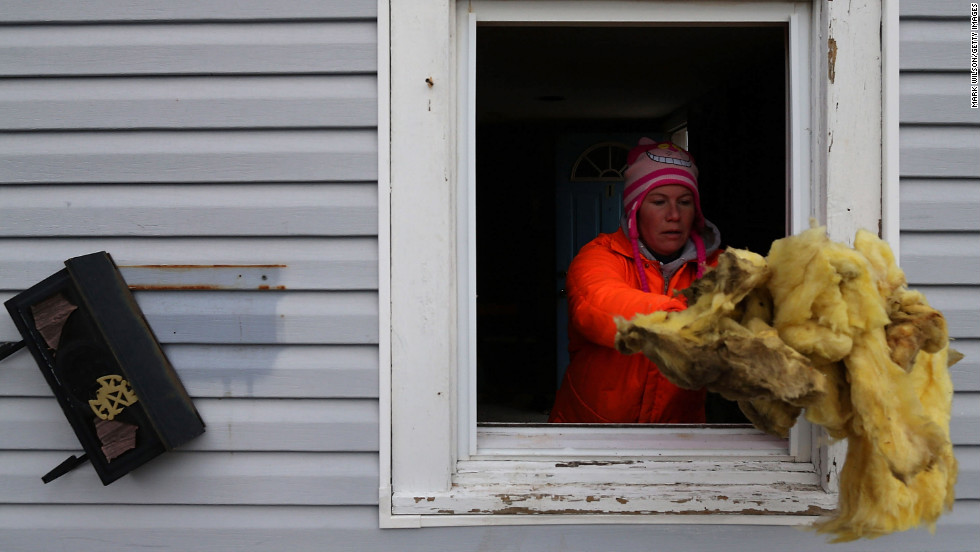 Rena McCain cleans out the first floor of her home in Seaside Heights on Sunday.