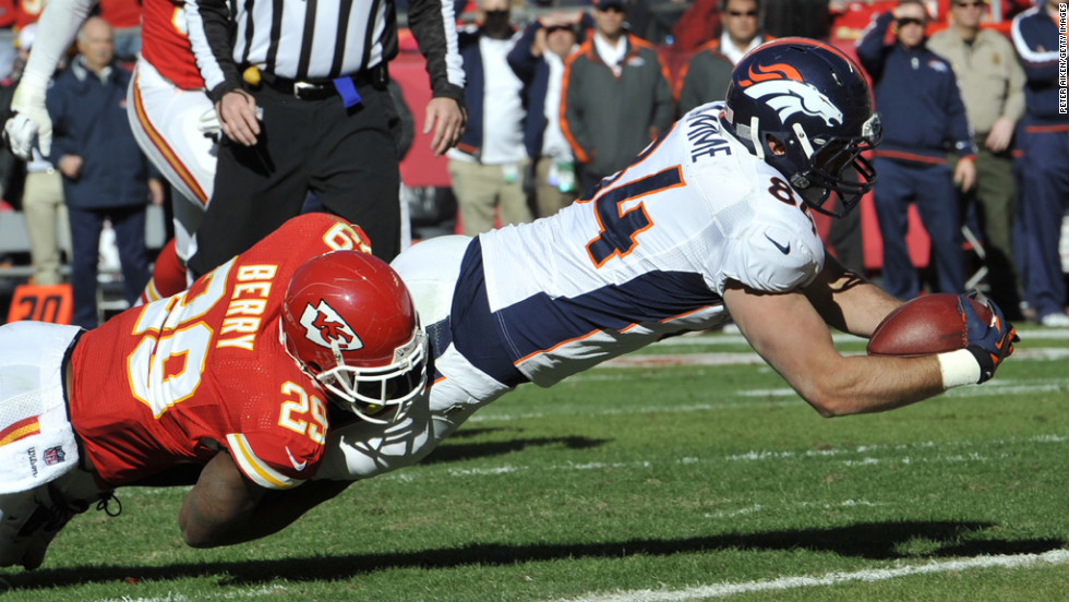 Tight end Jacob Tamme of the Broncos dives across the line for a touchdown against Eric Berry of the Chiefs during the first half on Sunday.