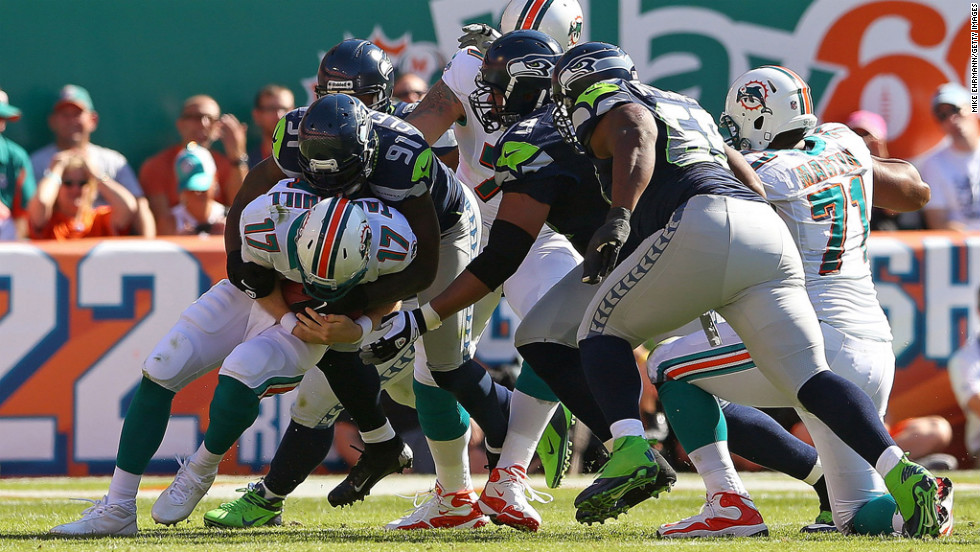 Ryan Tannehill of the Dolphins is sacked by Chris Clemons of the Seahawks on Sunday.