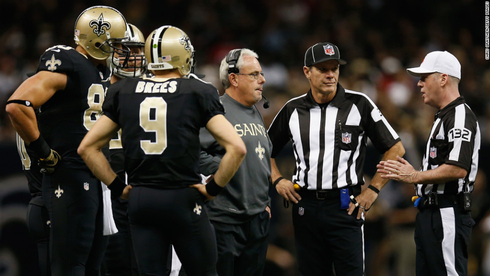 Interim head coach Joe Vitt of the Saints talks with referee John Parry during a timeout against the 49ers on Sunday.