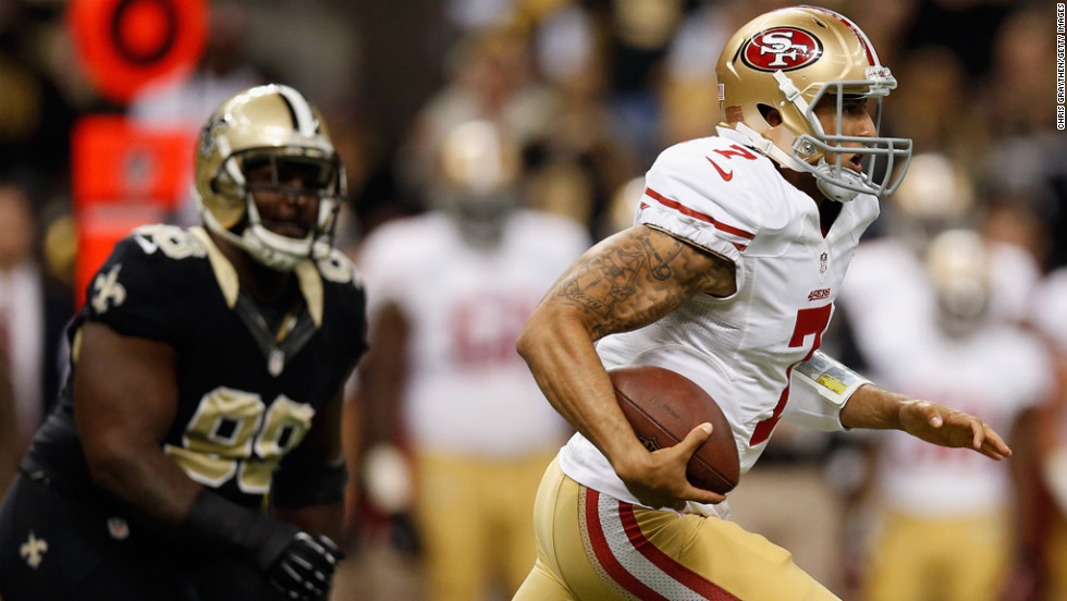 Colin Kaepernick of the 49ers runs with the ball against the Saints on Sunday.