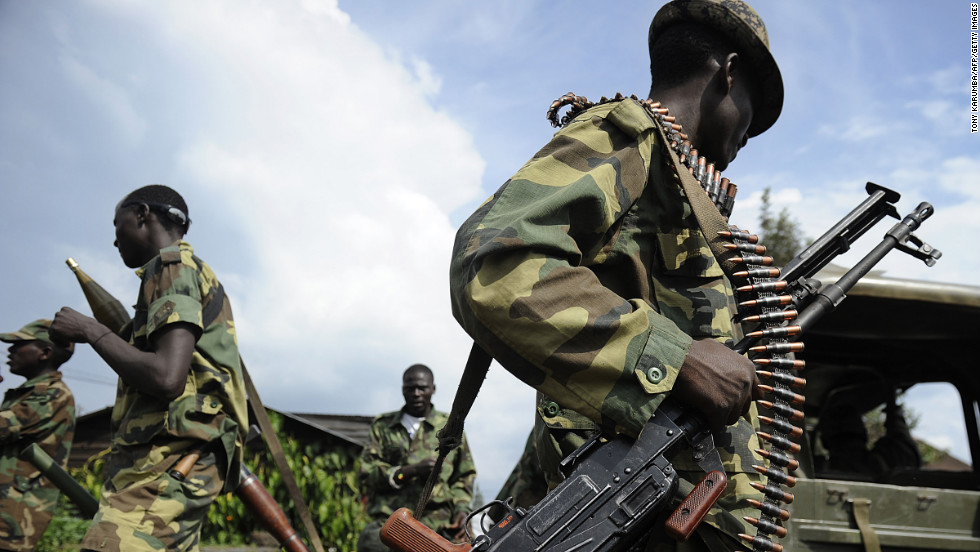 The M23 group launched an offensive in DR Congo in November 2012. Pictured, M23 soldiers stand guard at the former Congolese army headquarters in Goma, on November 23, 2012, after it was abandoned by fleeing Congolese army soldiers.