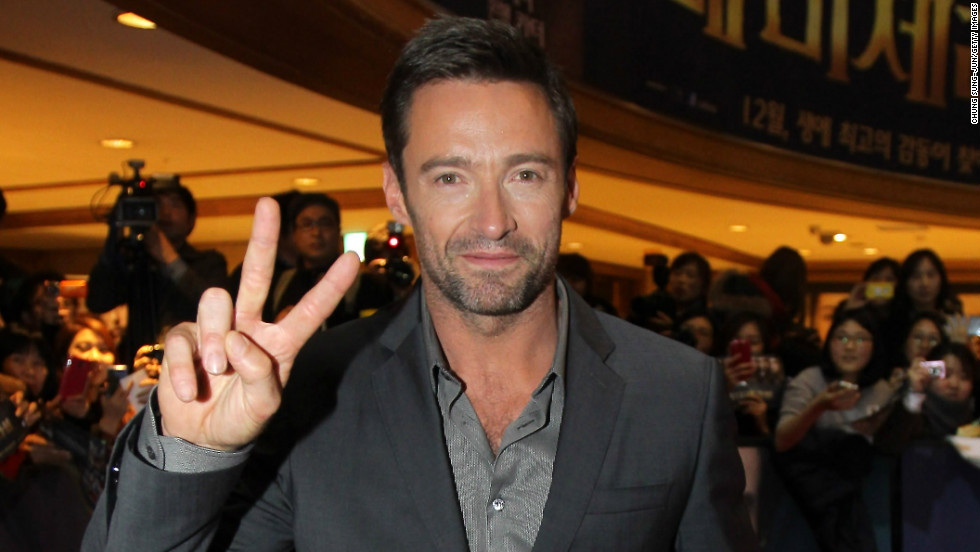 """Les Miserables"" actor Hugh Jackman flashes the peace sign at the film's South Korea premiere in Seoul on November 26."