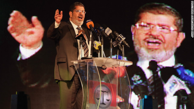 Morsy stands by power grab