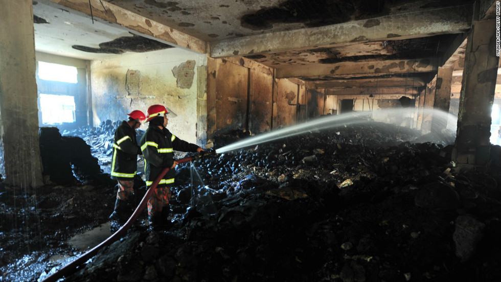 Firefighters douse hot spots on November 25.
