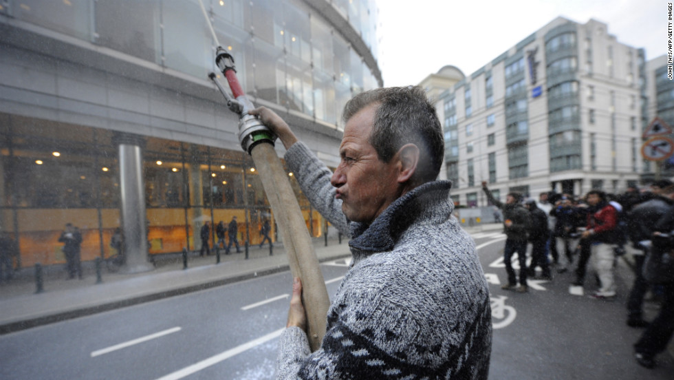 A demonstrator shoots milk in the air during Monday's protest.