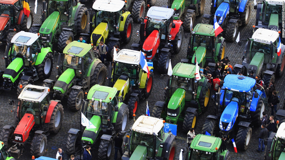 Farmers stand among hundreds of tractors during the demonstration on Monday.