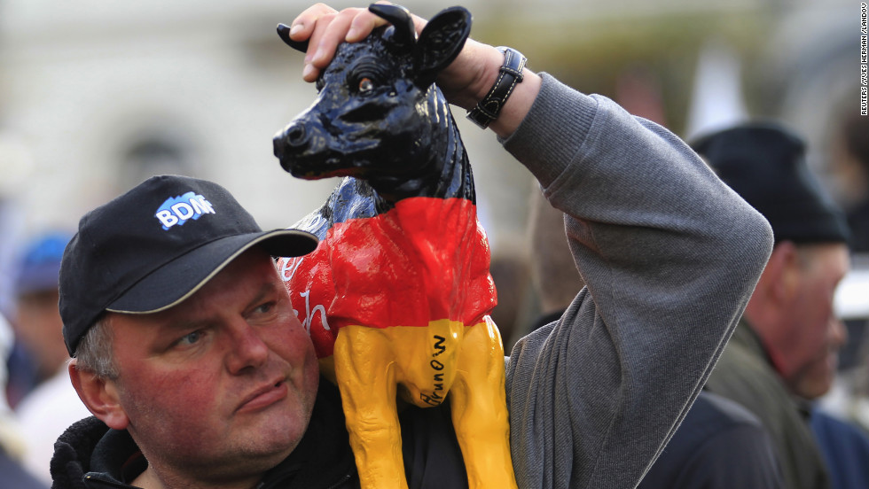A protester shows off his fake cow during Monday's demonstration.