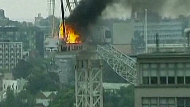 Video captures crane fire, collapsing
