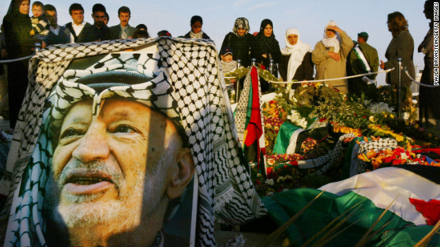 People visit the grave of Palestinian leader Yasser Arafat the day after he was buried in Ramallah, West Bank, in 2004.