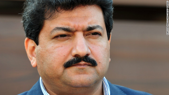 Pakistani journalist Hamid Mir talks with media outside his home in Islamabad on November 26, 2012.