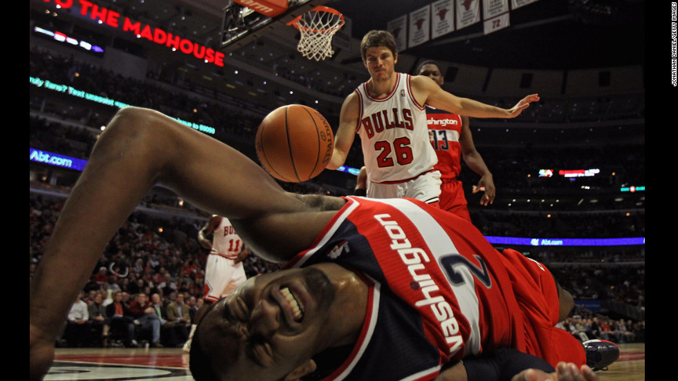 John Wall of the Washington Wizards hits the floor after taking a shot against Kyle Korver of the Chicago Bulls at the United Center on January 11 in Chicago.