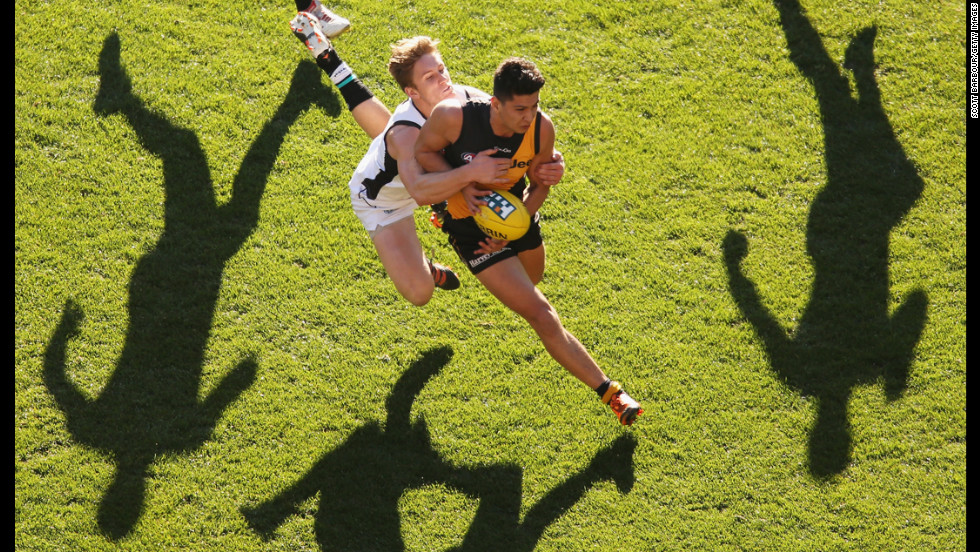 Robin Nahas of the Richmond Tigers is tackled during an AFL match against the Port Adelaide Power at the Melbourne Cricket Ground on September 2 in Melbourne, Australia.