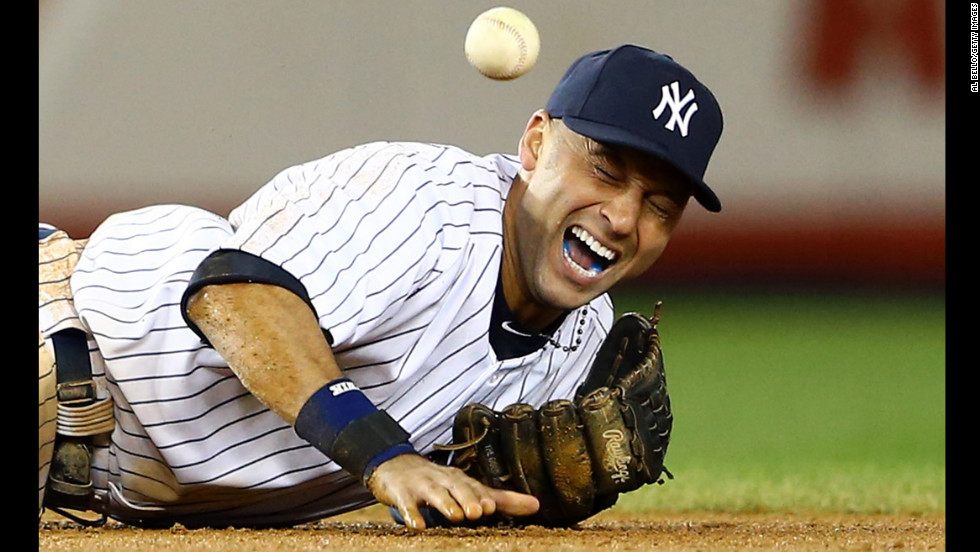 Derek Jeter of the New York Yankees injures his leg playing against the Detroit Tigers during Game 1 of the American League Championship Series at Yankee Stadium on October 13.