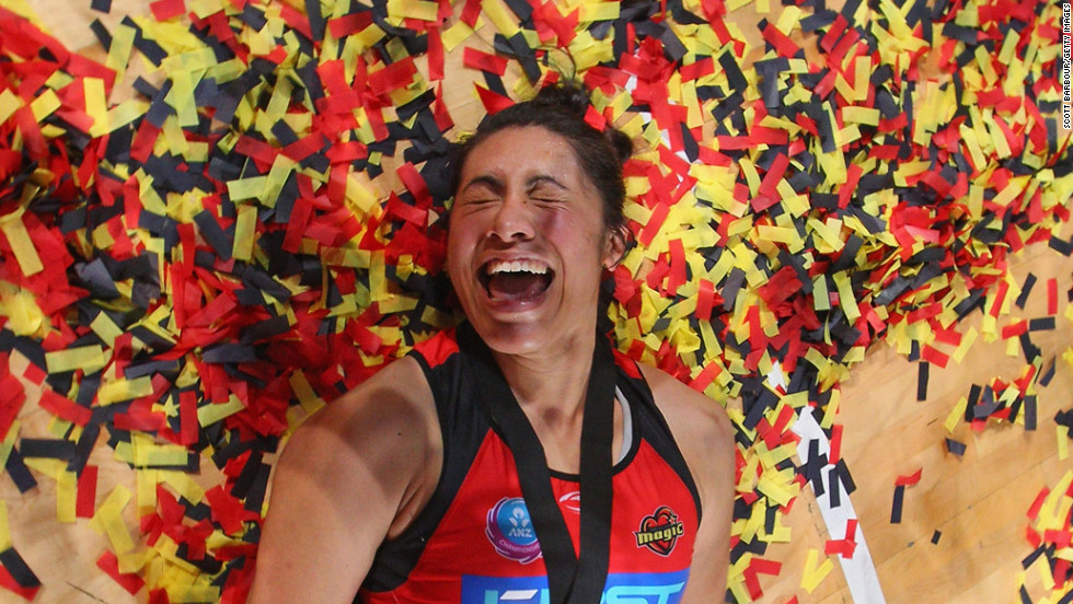 Julianna Naoupu of the Waikato Bay of Plenty Magic lies amongst the confetti after winning the Australian and New Zealand Netball League Championship match against the Melbourne Vixens on July 22 in Melbourne, Australia.