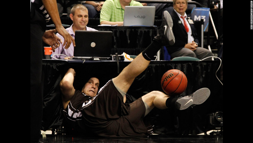 Justin Maneri of the Lehigh Mountain Hawks dives into the scorer's table after attempting to save the ball in the first half against the Duke Blue Devils during the second round of the 2012 NCAA Men's Basketball Tournament at Greensboro Coliseum on March 16.