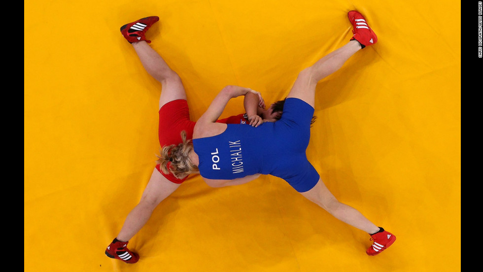 North Korea's Mi Gyong Choe, in red, competes against Poland's Monika Ewa Michalik in the women's freestyle 63-kg wrestling match on Day 12 of the London 2012 Olympics  on August 8.