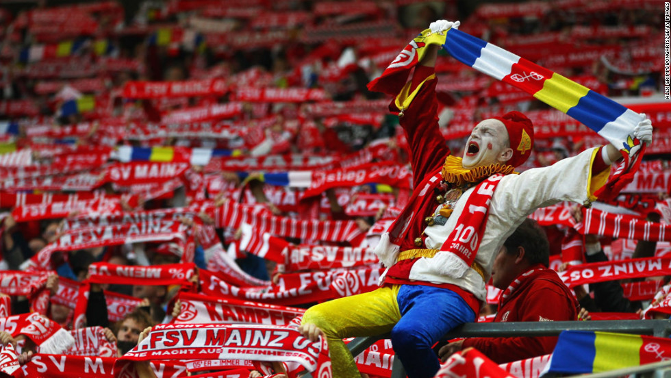 Supporters of the local team cheer prior to the Bundesliga match between FSV Mainz 05 and VfL Wolfsburg at Coface Arena on April 20 in Mainz, Germany.