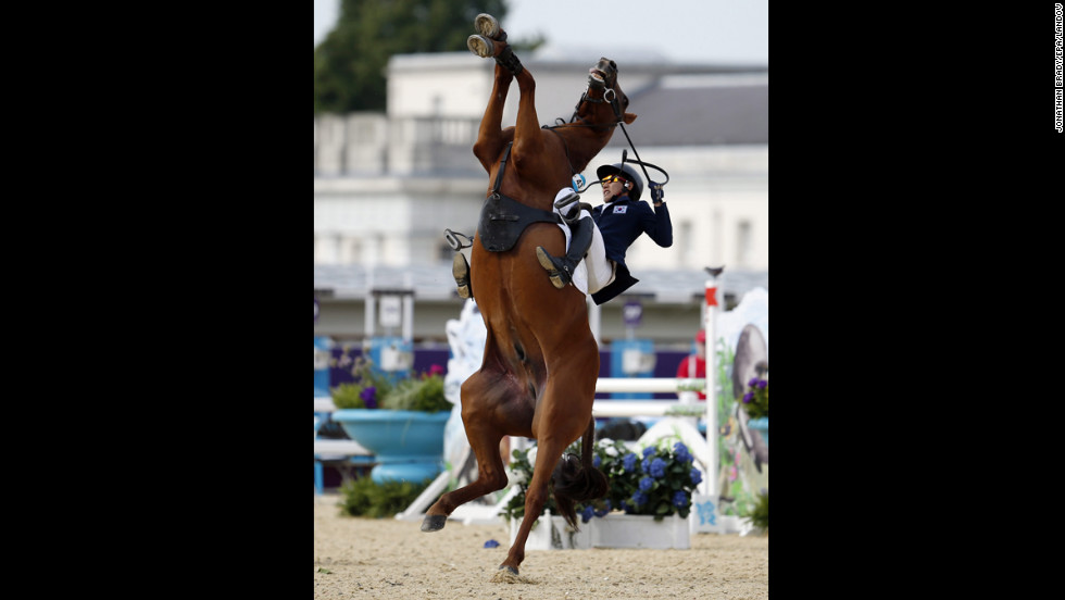 South Korea's Woojin Hwang is thrown from his horse Oscar Shearwater during the London 2012 Olympic Games men's modern pentathlon riding show jumping event at Greenwich Park on August 11.