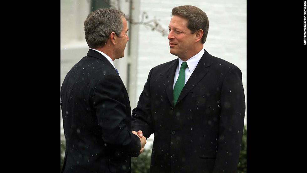 President-elect George W. Bush appears with his former Democratic rival then-Vice President Al Gore in Washington on December 19, 2000, after Bush had met with President Bill Clinton earlier in the day. The meeting with Gore was the first since Gore conceded the disputed election to Bush a week earlier and more than a month after Election Day.