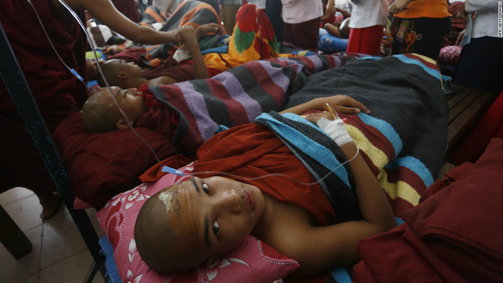 Monks receive treatment after a clash with police in northern Myanmar on November 29.