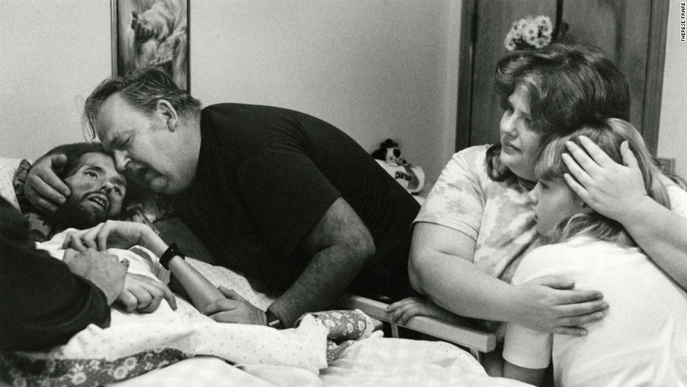 "The above image was published in LIFE Magazine in November 1990 showing AIDS patient David Kirby taking his last breaths surrounded by his family in Ohio. The image, shot by Therese Frare, became the face of the HIV/AIDS epidemic. See the entire collection of images on <a href=""http://life.time.com/history/behind-the-picture-the-photo-that-changed-the-face-of-aids/?iid=lb-gal-viewagn#1"" target=""_blank"">Life.com</a>."