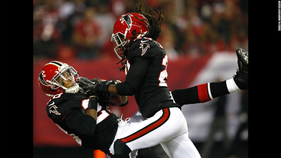 Thomas DeCoud of the Atlanta Falcons intercepts a pass in the end zone of the New Orleans Saints on Thursday.