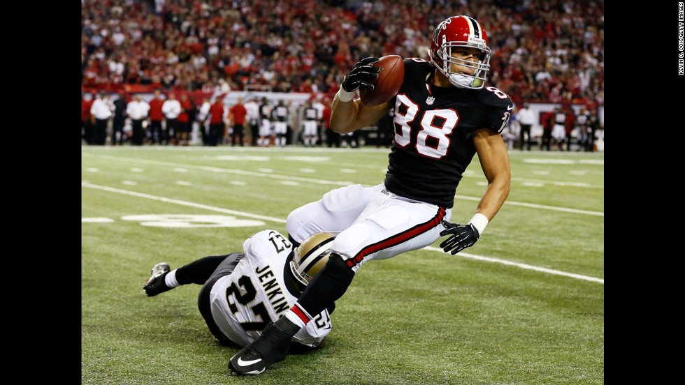 Tony Gonzalez of the Atlanta Falcons is tackled by Malcolm Jenkins of the New Orleans Saints on Thursday.
