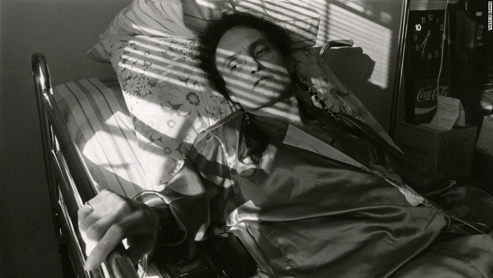 "Peta lays in a bed at Pater Noster House in 1992. See the full gallery at <a href=""http://life.time.com/history/behind-the-picture-the-photo-that-changed-the-face-of-aids/?iid=lb-gal-viewagn#1"" target=""_blank"">Life.com</a>."