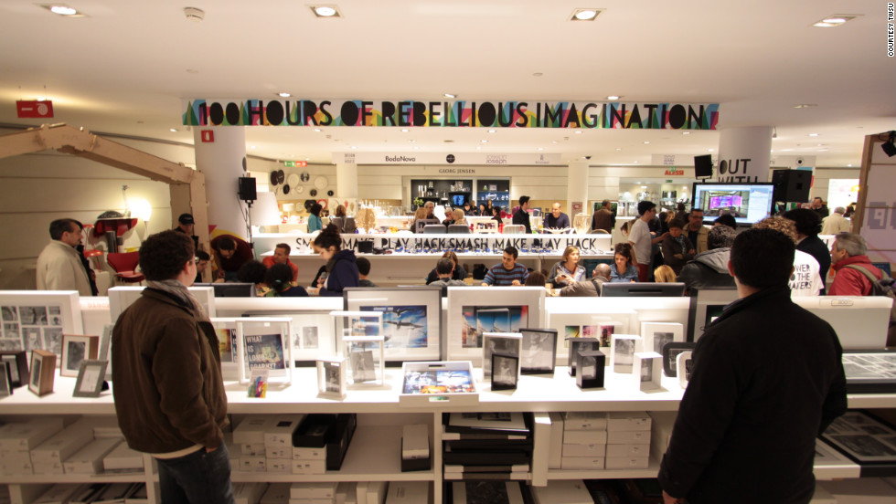 """Makers"" events and open spaces, also known as ""hackspaces"" have sprung up all over the world in recent years. At a recent event in Milan, one banner reads ""hours of rebellious imagination"", while another says ""play, smash, make, play, hack."""