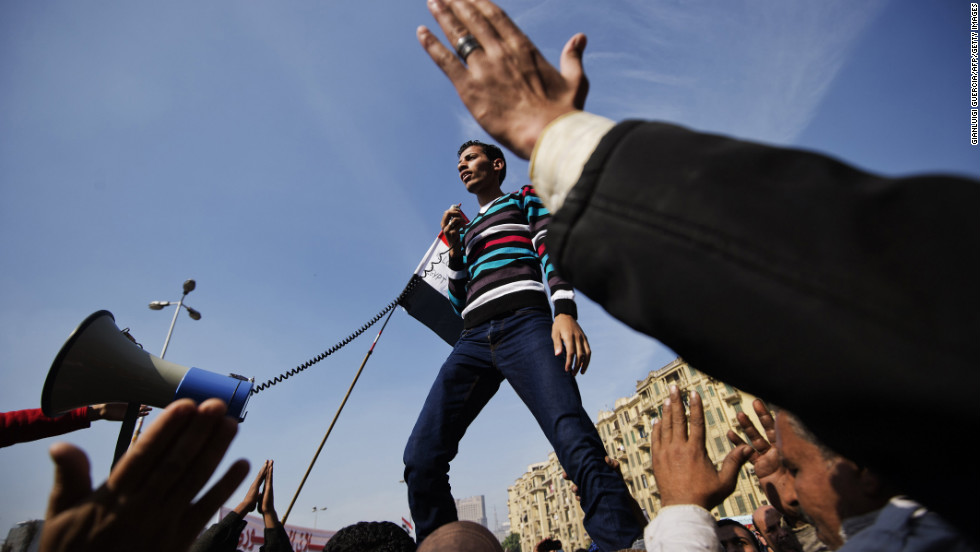 An Egyptian man delivers a speech as protesters gather in Cairo's Tahrir Square on Friday, November 30.