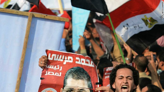 A man holds a portrait of Egypt's President Mohamed Morsi as he takes part in a rally gathering thousands of Islamists in front of Cairo's University on December 1, 2012, in support of Morsi's new expanded powers and the drafting of a contested charter, in a clear show of Egypt's widening polarisation. The demonstration in the heart of Cairo comes a day after tens of thousands of Morsi